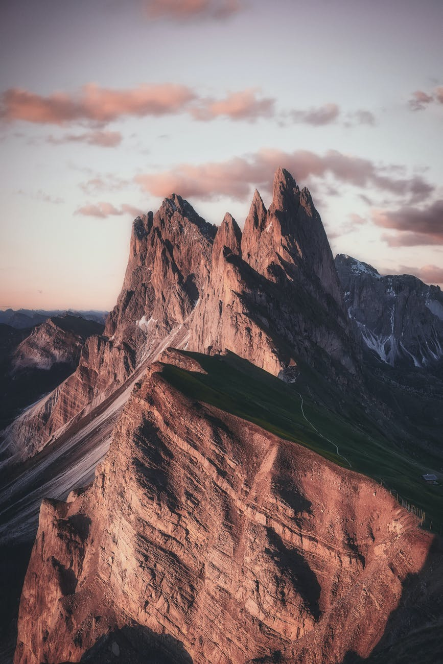 mountain range under beige sky