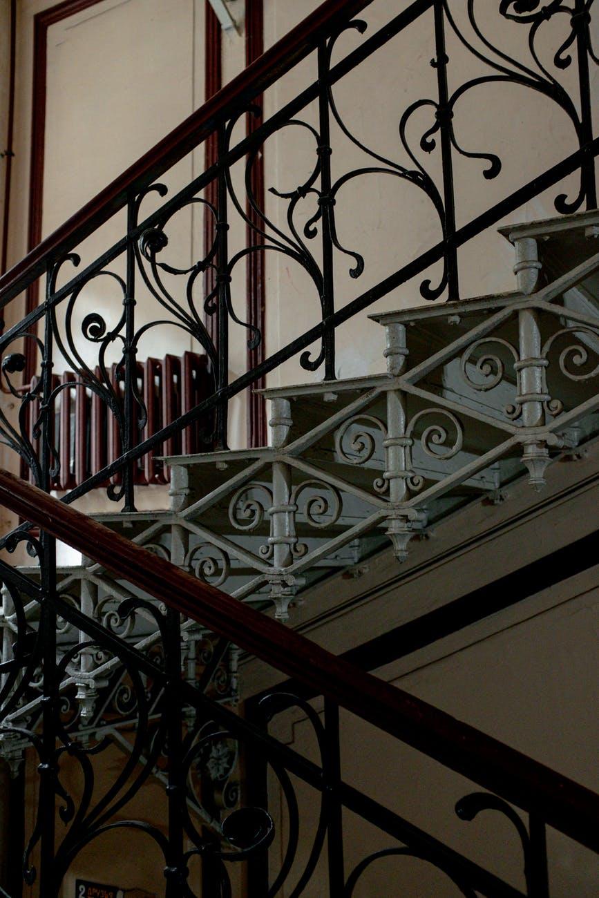 black metal staircase railings near staircase